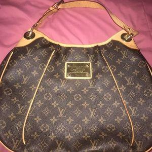 LV, hobo style handbag.